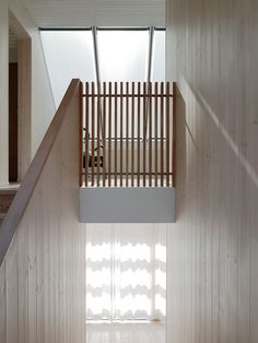 Large windows and skylights let daylight fill the summer house, reflecting off the light wood-clad walls and floors and white-painted ceilings.