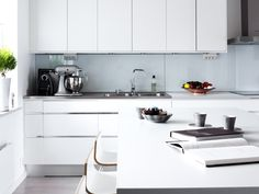 white cabinets and stainless steel countertops