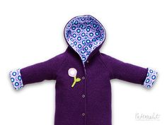 Purple/lilac wool toddler/child winter coat, lined with organic jersey cotton with matching flower appliqué.
