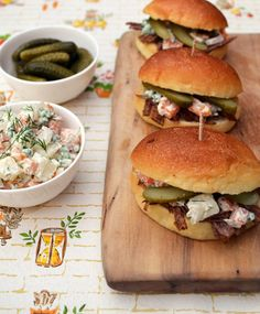 Beef brisket sliders with Russian salad and gherkins.