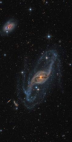 astrotastic:  afro-dominicano:   Twists of NGC 3718 by Mark Hanson  A careful look at this colorful cosmic snapshot reveals a surprising number of galaxies both near and far toward the constellation Ursa Major. The most striking is NGC 3718, the warped spiral galaxy near picture center. NGC 3718's spiral arms look twisted and extended, mottled with young blue star clusters. Drawn out dust lanes obscure its yellowish central regions. A mere 150 thousand light-years to the right is another ...