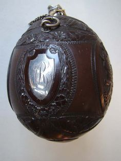 A superbly carved and silver mounted late 18th century Coconut shell gunpowder flask circa 1790