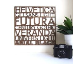 metal wall hanging with various fonts.