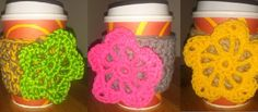 Set of three crochet coffee cup sleeves.