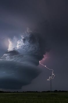lightning from large rotating storm (at this point, almost a large tornado).... Broken Bow, Nebraska by johnfinney