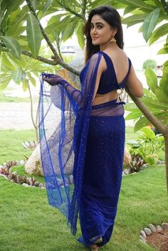 The hot and unseen sexy phoshoot collection of talgu south actress sony charistha in her blue sarri with navel show that are looking so sexy...