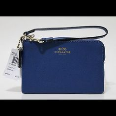 """HP NWT Coach wristlet NWT BRIGHT MINERAL BLUE CROSSGRAIN LEATHER W/ZIP CLOSURE                                                Two credit card pockets Dogleash strap attached 6 1/4"""" (L) x 4"""" (H) Comes with Coach care instructions and gift box   BLUE fabric lining (water & stain resistant) Coach Bags Clutches & Wristlets"""