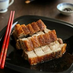 Classic Cantonese Crispy Pork Belly aka Roasted Pig or Siu Yuk made at home with step-by-step recipe.