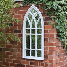 White Arched Window Mirror Beautifully designed wall mountable mirror which can also lean against a wall In a unique arched window design This is made from wood with a washed white painted finish Would make a statement in a garden £75.95 www.melodymaison.co.uk