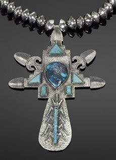 "This sterling silver tufa cast Corn Maiden necklace by Navajo artist Gerald Lomaventema is set with gem quality Kingman turquoise. The necklace measures 13"" and the pendant measures 4"" x 2 7/8."""
