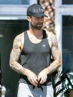 Star Tracks: Tuesday, September 30, 2014 | ARM CANDY | The Voice mentor Adam Levine shows his Los Angeles pride – and totally fit physique! – on Monday while running errands in Beverly Hills.