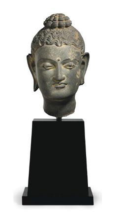 A gray schist head of Buddha -  GANDHARA, 2ND/3RD CENTURY | Christie's