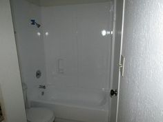 The bathtub was refinished, completing the spotlessly clean appearance of this bathroom.