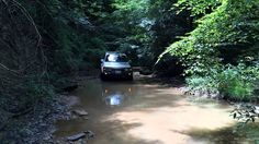 1997 Toyota Land Cruiser driving through a creek crossing. Land Cruiser 80, Toyota Land Cruiser, Offroad, Off Road