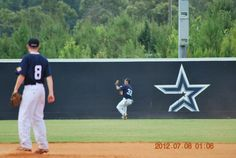 Tracking down a rope in CF at the Perfect Game Showcase in East Cobb, GA; circa 2012.
