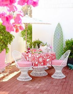 Don't love these chairs, but the patio is cute and I LOVE how this pic was taken with the flowers in the pic.