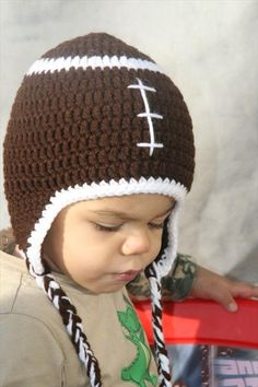 this is for inspiration, don't seem to be able to find the pattern-football baby hat