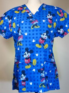 #caringplus scrub top -Mickey Graphics Blue - CaringPlus scrubs and uniforms - workwear clothing for nurses, caregivers and other healthcare professionals.  Perfect apparel for doctor, dental and optician offices, nursing homes, rehab centers, vet clinics, animal hospitals, or medical labs.