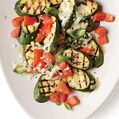 Caprese Zucchini gives a nod to the classic Caprese salad as an Italian-inspired topping for this summer veggie.