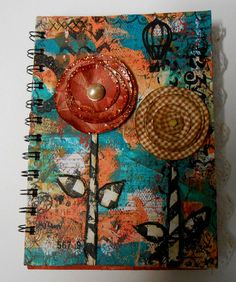 Mixed media on the cover and back of this beautiful journal for writing not