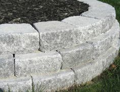 Staggered rows of pavers adds strength to raised bed walls. Staggered rows of pavers adds strength to raised bed walls. Staggered rows of pavers adds strength to raised bed walls. Backyard Retaining Walls, Building A Retaining Wall, Garden Pavers, Patio Pergola, Building A Raised Garden, Garden Edging, Raised Garden Beds, Garden Stones, Raised Patio