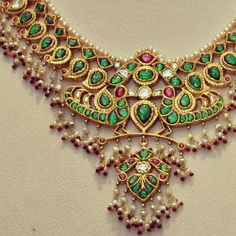 Gold and emerald necklace with pearls and rubies by Amarapali
