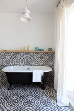 Renovating your bathroom in 2017? Think: bold colors, dark metals, and vintage accessories. These trends are perfect ways to elevate the tiniest bathrooms. For