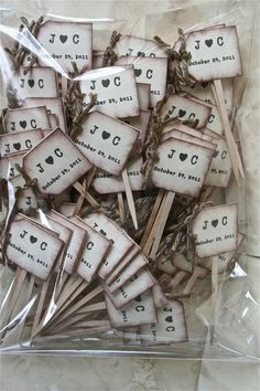 Cupcake toppers! Aww! It's even a J and a C in the sample!
