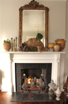 with bee hive, tree root, french pots, candles. my idea of decorating, natures best