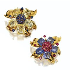 PAIR OF YELLOW AND BLUE SAPPHIRE AND RUBY FLOWER BROOCHES, VAN CLEEF & ARPELS, PARIS, CIRCA 1945.