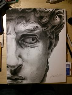 Pencil/Graphite photo-realistic drawing of a section of Michelangelos David  11 x 17 in. Includes frame