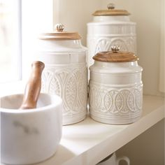 Ivory Farmhouse Canisters Whether you live in the city or in the country, our farmhouse-style canisters are the cream of the crop. Plant them on a countertop and reap the compliments. Each features a carved mango wood handled lid. Luxury Home Accessories, Decorative Accessories, Decorative Accents, Vintage Accessories, Kitchen Accessories, Farmhouse Style, Farmhouse Decor, Modern Farmhouse, White Farmhouse