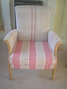 A beautiful Parker Knoll chair upholstered in a linen grain sack and soft cotton fabric
