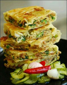 Martabak telur (egg with ground mutton or beef and green onion wrapped in similar to spring rolls wrapper and fried) - (This pin no longer goes anywhere, but just look at the yummy photo! Indonesian Desserts, Indonesian Cuisine, Indonesian Recipes, Asian Appetizers, Asian Snacks, Indian Food Recipes, Asian Recipes, Ethnic Recipes, Onigirazu