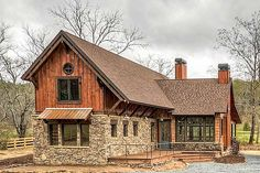 With its striking good looks and rustic exterior, this Mountain house plan would look great lakeside or mountainside.The two-story great room is flooded with light from windows on three sides and has a big fireplace to cozy up to.An open terrace and covered porch give you the option for sun or shade depending on your mood.The master suite enjoys privacy from being the only bedroom on the main floor.Loft space upstairs has two balconies, one to the outside and one that overlooks the great…