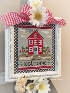 Good morning! Don't you just love red and aqua... and gingham and daisies? :) This week I was taking down all my Easterish stitched ...