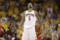 Cleveland Cavaliers guard J.R. Smith (5) reacts after hitting a 3-point shot against the Atlanta Hawks in the first half during Game 2 of a second-round NBA basketball playoff series, Wednesday, May 4, 2016, in Cleveland. (AP Photo/Tony Dejak)