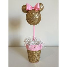 Great for any Minnie Mouse Party!  This is a custom party decoration, you can choose: glitter color, number and or character. Centerpieces average