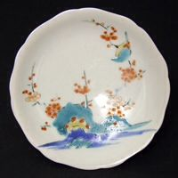 A Japanese Kakiemon Nigoshide Porcelain Saucer c.1690. Decorated with a Bird on a Prunus Branch. The `Nigoshide` body was a new whiter body introduced in between about 1660 - 1680 solely for Kakiemon wares. Indeed the Kakiemon palette also evolved at the same time. It has recently been proposed that the Nigoshide body is not a new body at all, rather it is just made from a clay that has been levigated and washed more.