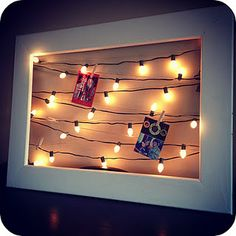 CHRISTMAS CARD DISPLAY - I like this idea.  Use christmas lights (especially the new tiny led lights!)