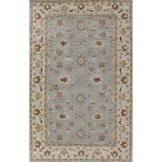 Outfit your living space with this beautiful artisan-made rug. Hand-tufted of natural wood, this inviting rug features a floral motif in shades of blue and beige.