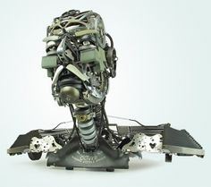 Jeremy Mayer makes extremely detailed sculptures of humans and animals out of recycled typewriter parts.  California based artist reassembles typewriters into anatomically correct human and animal figures. He does not solder, weld, or glue these unique assemblages together - the process is entirely cold assembly.