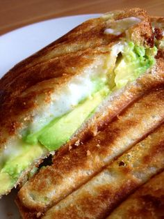 Avocado and provolone toasted sandwich.