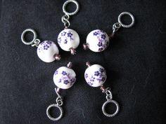 White and purple stitch markers by KatKeRosCorner on Etsy, $10.00