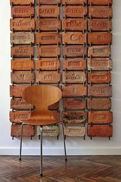 If I help you collect weird plates will you help me collect weird bricks?  Talk about a statement wall!