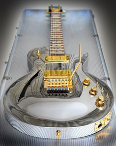 Chrome Les Paul with gold hardware.nice Not so crazy about the gold but the guitar is really cool Guitar Art, Music Guitar, Cool Guitar, Playing Guitar, Pink Guitar, Guitar Chord, Guitar Tattoo, Guitar Strings, Les Paul