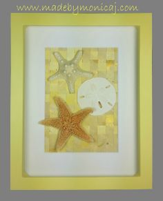 8x10 Shadow box frame.  Knobby starfish, sugar starfish, and sand dollar displayed on a woven hand painted paper background.