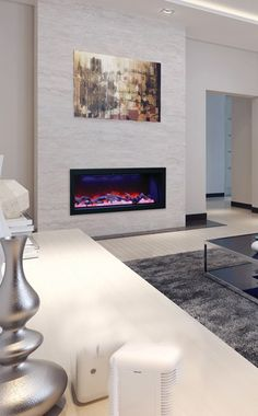 Amantii BI-50-DEEP electric #fireplace, shown with logs and Himalayan salt inside.