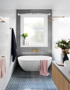 Houzz.com   mosaic/pattern floor tile, grey subway tile, freestanding tub with doorless shower, floating vanity.