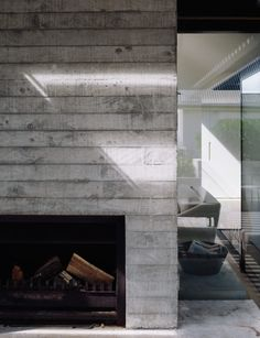 The concrete fireplace surround shows the marks from the rough-sawn timber formwork used in its construction.